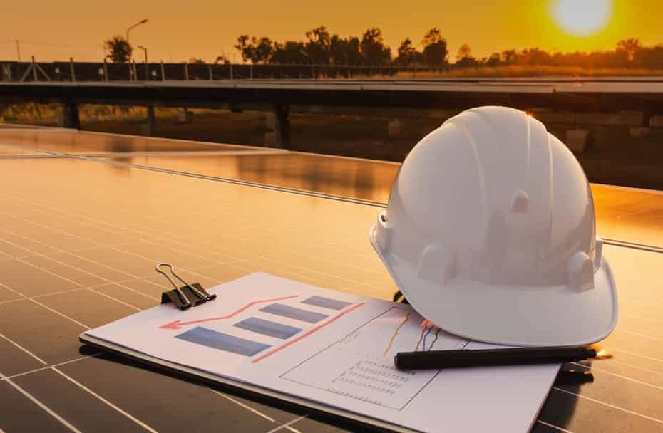 Project Execution (image of hard hat on solar panel)